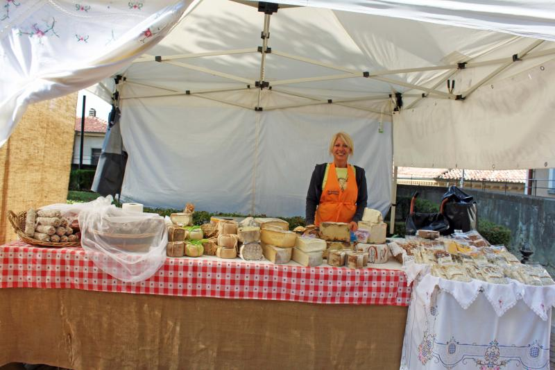 In the farmers market, selling cheese
